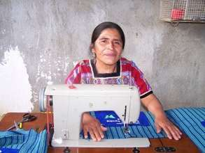 Angela works on her sewing machine
