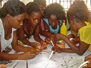 Girls learning new job skills at FAIR Fund