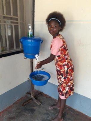 Keeping safe - hand washing at Kimbilio