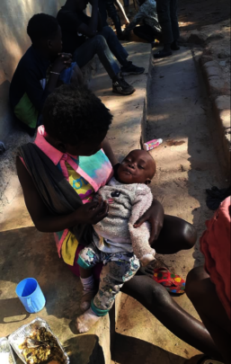 Mum and baby supported by Kimbilio team