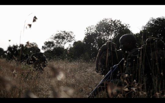 Armed rangers in the field.