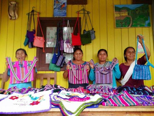 Female weavers showing their work