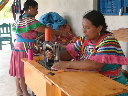 Woman using the sewing machine