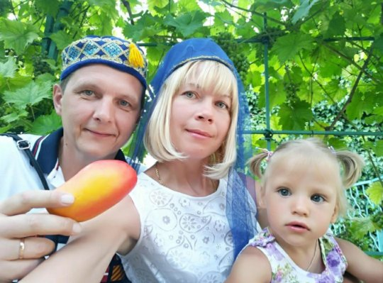 Julia, Sergey and their daughter