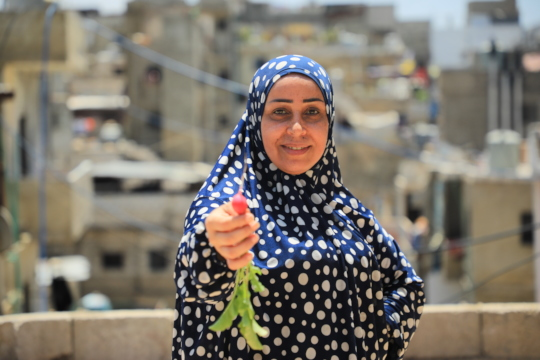 Ghada from Shatila Camp proud to share her harvest