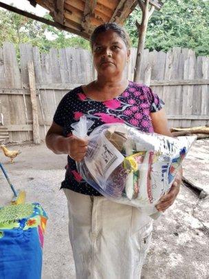 Community Members in Talanga receiving food ration