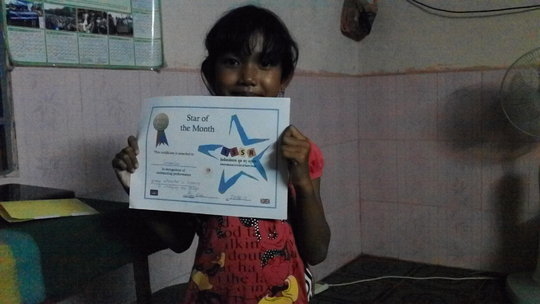 Somalin Showing Off Her Certificate