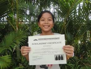 Vattana with her scholarship certificate!