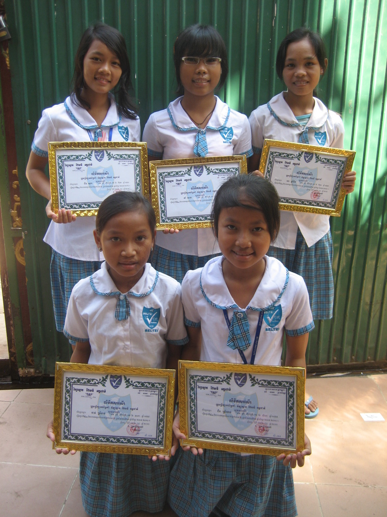 Sokha (in the back, left) with an academic award