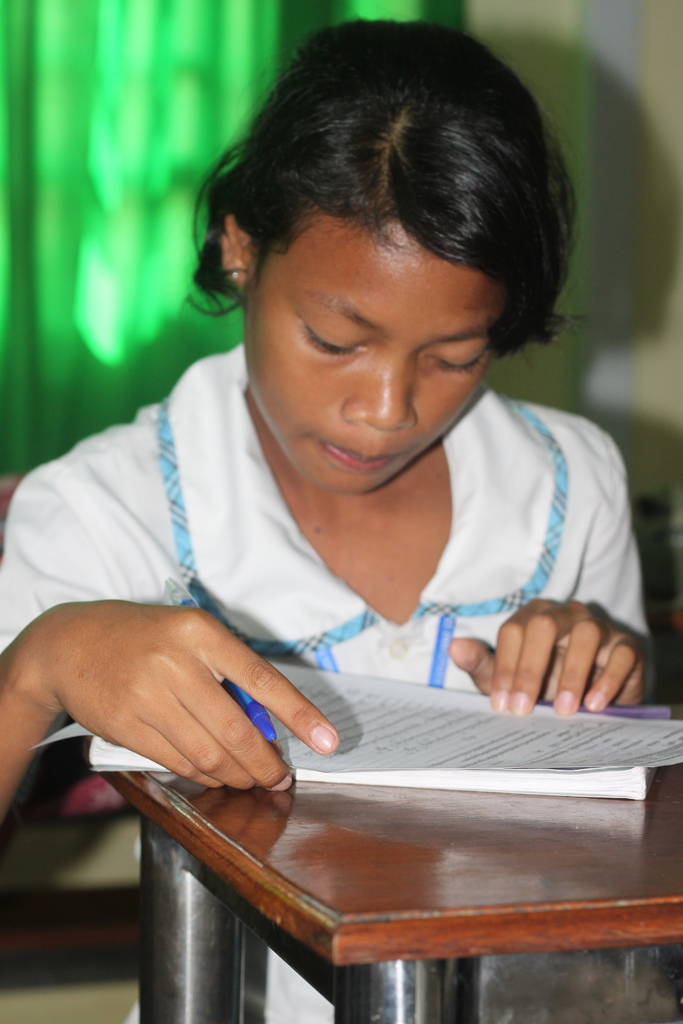 Channa taking a test in school - she earned a 100%