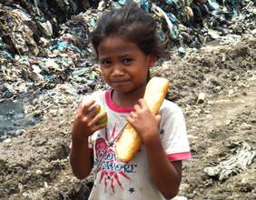 On the Garbage Dump - Girl Recieves Food