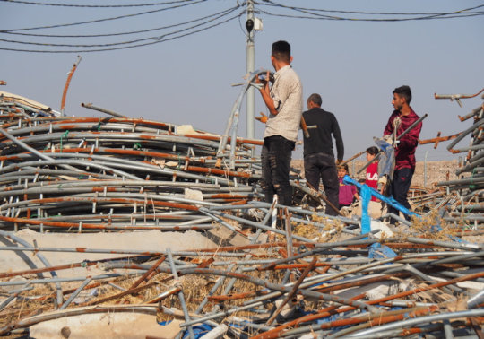 Gathering discarded material to build shelters