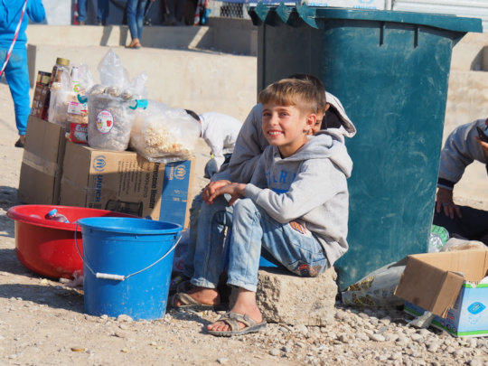 This young boy is selling cokes and water