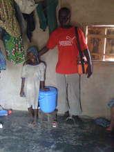 Girl in Gidanturu w/her CWS safe storage container