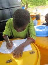 Boy helping us monitor water sales in Gidanturu