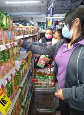 Our staff shopping for home food baskets