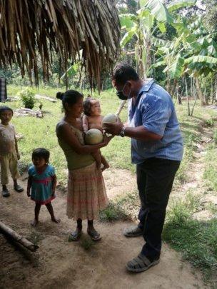 Don Armando distributing melons to local families
