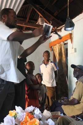 Showing villagers the Solar Light 1