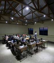 Classroom studying by solar lights in the evening