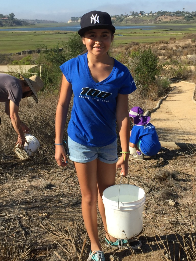 Volunteers hand-water 1500 native plant species