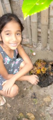 Third grade student Amy with her compost evidence