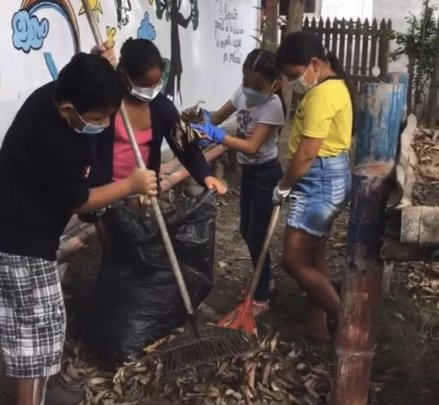 Fourth graders prepare garden for vegetable beds