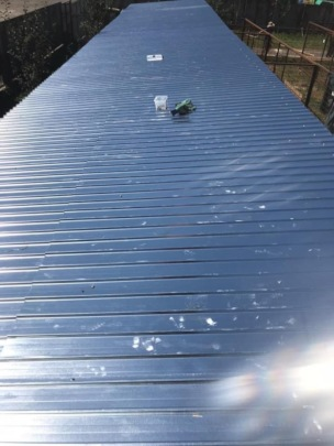 long row of sheets to build the roof