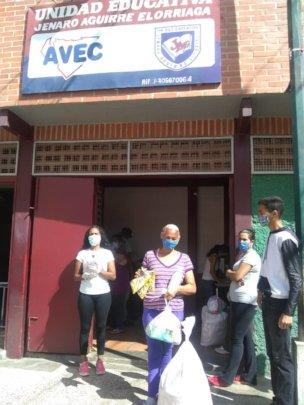 Giving bags: food, hygiene items & school supplies