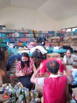 Volunteers meet at an AAI sponsored school library