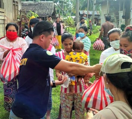 AAI volunteer giving care packages to families
