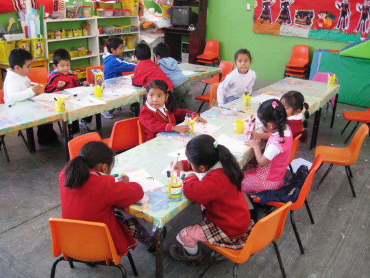 The children enjoy drawing at the Center.
