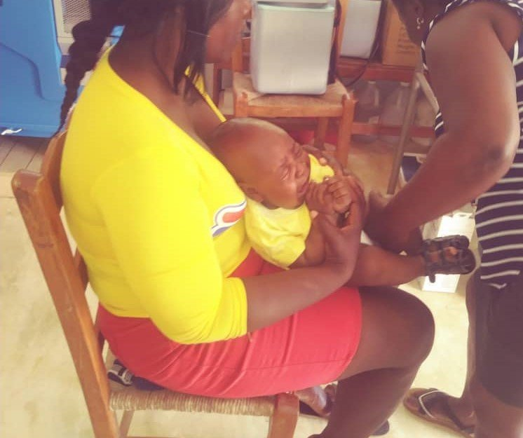 Healthy baby gets vaccine and attention