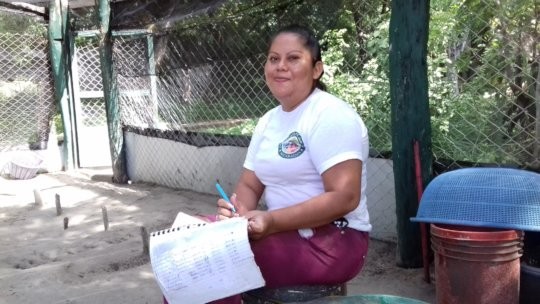 Female ranger Liessi recording nest data