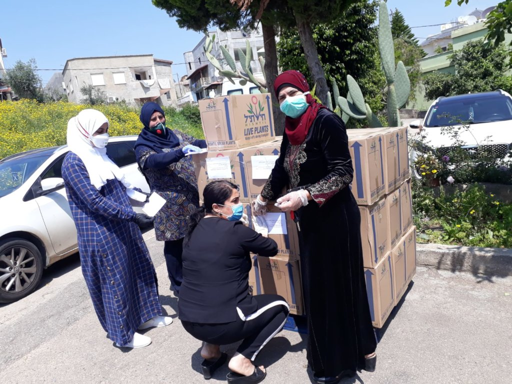 Grassroots women prepare packages of basic goods