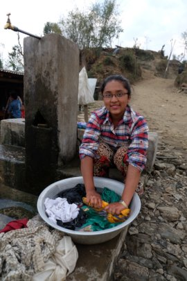 Girl washing her clothes