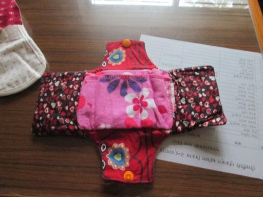 Sanitary pad manufacture.