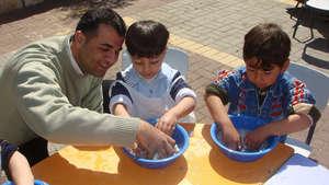 Ahmad helps children