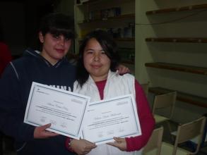 Maria and Gabriela show off their achievement