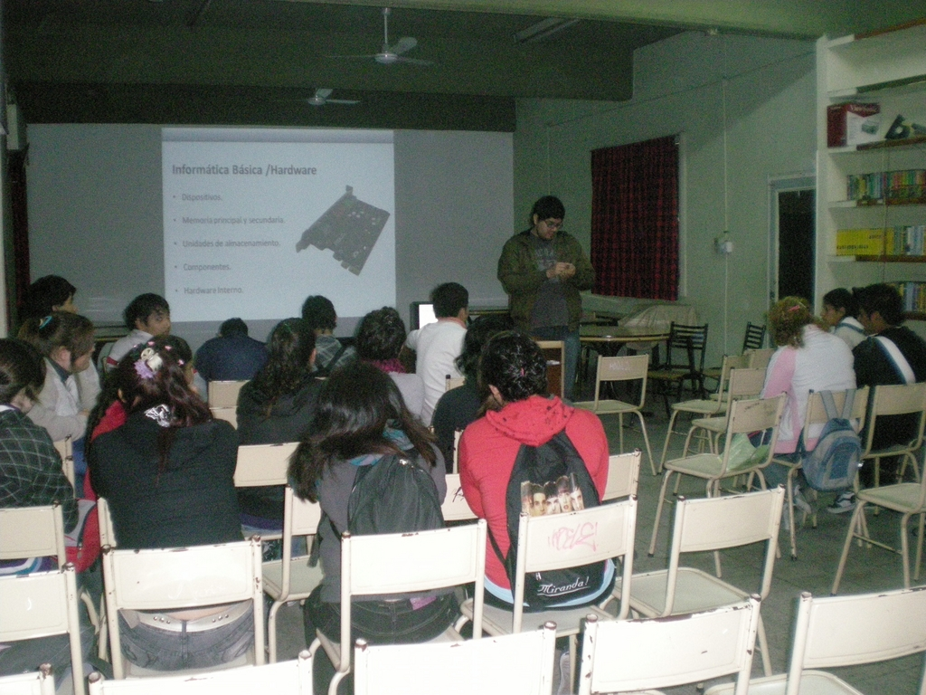 Students getting a basic IT lesson