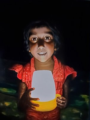 School girl with solar lantern