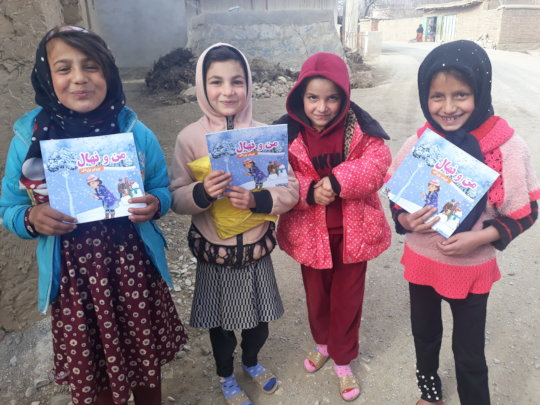 Young girls receiving the books, Kapisa province