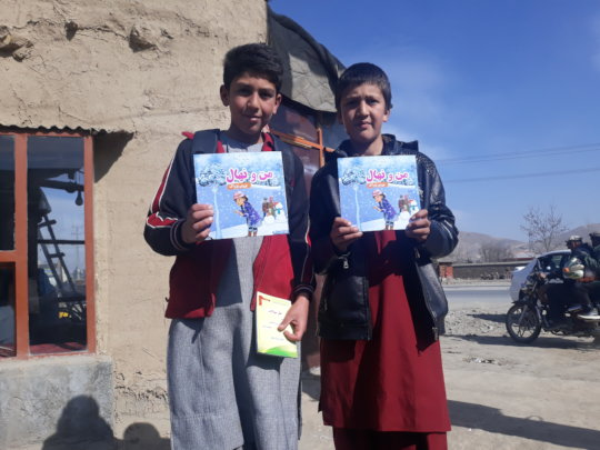 Children receiving the books, Kapisa province