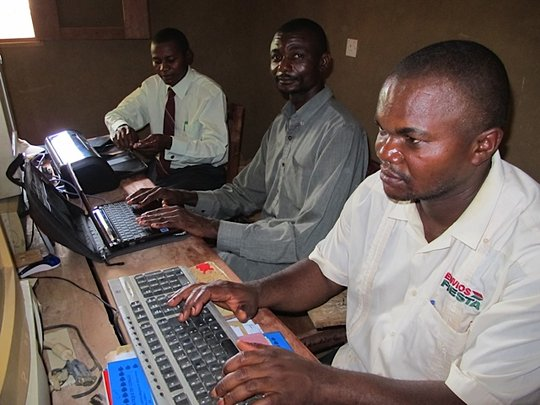 Students learning to use computers