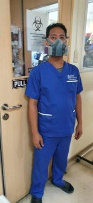 Benjie Balleros, Lab Aide wearing the respirator