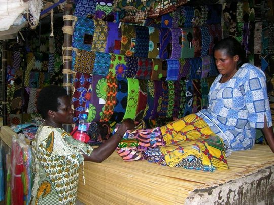 Purchasing fabric in the Arua market