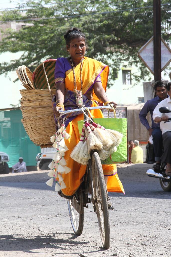 Baby while doing doorstep marketing on her bike