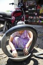 Uma Chavan Repairing Motor-bike