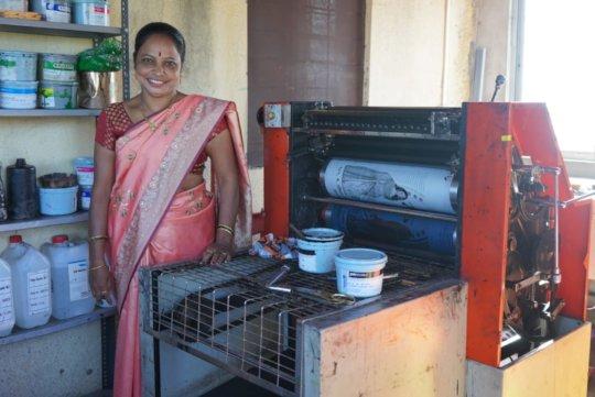 Vanita with her bag printing machinery