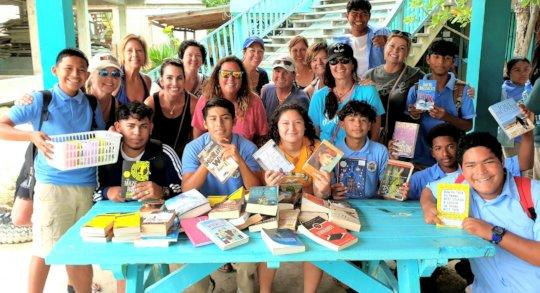 Visitors to OA bring books & school supplies