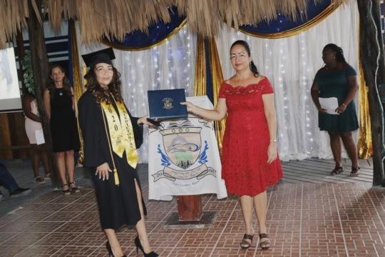 Valedictorian D. Novelo and Board Chair S. Pesos